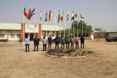 Students standing by the flag of their country